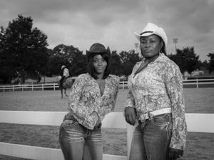 Melissa Ellison is an nurse and Melissa Brown works in accounting for a forest products company. They're trail riders and were attending the Bill Pickett Rodeo in Atlanta, GA on August 2 & 3, 2014. © Forest McMullin