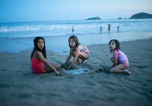 Girls play at sunset. Ixtapa.