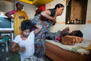 a group of hijras that live in Thane, Mumbai relaxing and fooling around at home - Most hijra have a very vivacious, playful relationship with the members of their group.  © Alison McCauley