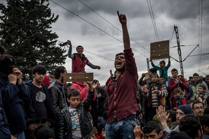 Migrants protest for open the borders in Idomeni refugees camp on the border between Greece and FYROM (Macedonia) on March 12, 2016.