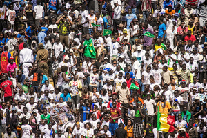 Over 20000 fans gather to attend the fight between the wrestling champions Balla Gaye 2 and Emeu Sene at the sold out soccer stadium Demba Diop in Dakar, April 5, 2015. Each wrestler has his own fans who support him and are engrossed in the fight. Many of them hold up posters and banners with pictures of their preferred wrestler.
