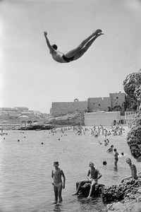 A man diving in front of Dubrovnik's walls. Yugoslavia, 1953