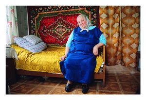 Antanina Kacuceviciene is all alone at home, after her children and grandchildren left looking for jobs in Spain, Portugal and England. She let a young family inhabit the first floor of her house in exchange for chopped firewood and water brought to the house, and she rented out a room with a door to the church square for a small shop that since went bankrupt. © Mindaugus Kavaliauskas