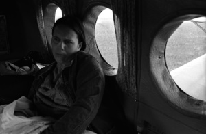 A woman with a newborn child on the board. The flight  from Kargasok to Noviy Vasyugan. The young mother had to fly to give birth to her child to the district center as maternity hospital in Noviy Vasyugan was closed. The flight runs several days a week along the Vasygan river, airplane stops on demand in those settlements where there are conditions for landing. Tomsk region. Russia. 2009