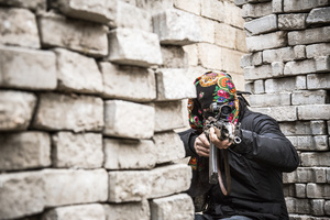 Deniz Bagok, a male guerilla fighter of the YPS, while training between high barricades in Kurdish-dominated city of Nusaybin in southeast Turkey, near the Syrian border. Heavy gunfights took place during several curfews between Turkish government special forces and Kurdish YPS guerilla fighters.