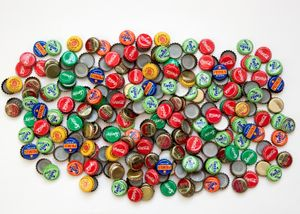 "The bottle caps of all the drinks we bought to get this project done (270 caps in total). From ""Only in Burundi"" © Anaïs López"
