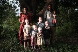Florence, Semabulia, Sekiringa, Semuju, Naburja, Mwanje Bernard and Mwanje carrying Marry