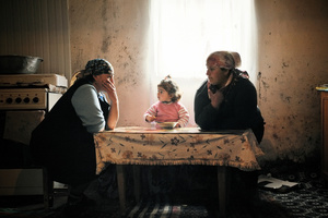 After work, Two women sit down in the kitchen at their farmhouse in Mirashkhani.