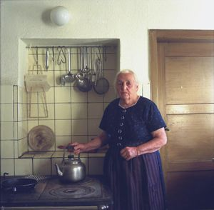 Maria Strecker in her kitchen, Black Forest, 2011. From the series: The last women in their traditional peasant garbs