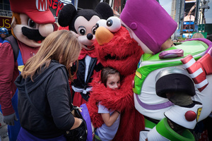 Children love to hug comic heroes and most parents don´t mind to tip the costumed characters for being friendly with their little ones. Many of the people behind the masks of Mickey Mouse, Elmo and Super Mario work up to 12 hours a day.
