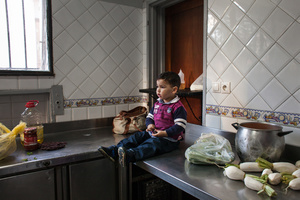 """Casablanca, March 2015. This child waits for his mother while she is finishing working in the kitchen of the restaurant of the NGO """"Solidarité Feminine"""". Many of the girls have the opportunity to work and care for their children, inside the Association."""