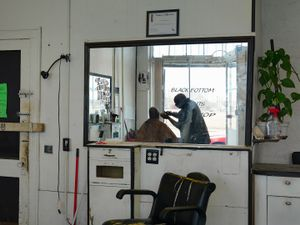 Tirrelle Giving a Haircut and Trim, Black Bottom Cuts, Eastside, Detroit 2014