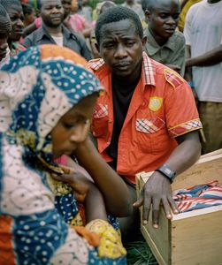 A father mourns at the funeral of his murdered 7-year old son, Damas. The belief in sorcery includes a dogma that a rope used to commit suicide has inherent powers; the rope can be sold in markets in Burundi and Tanzania for thousands of dollars to believers who claim it will give them black magic powers.  Damas' murdered was staged to appear as a suicide by hanging. © Diana Zeyneb Alhindawi