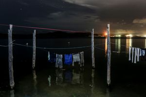 Clothes drying above rising sea tide