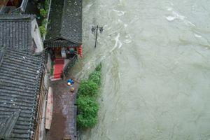 Washing in the Flood, Fenghuang, Hunan, China.