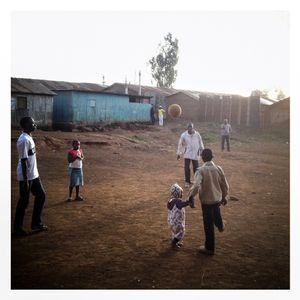 A family play with a ball in Kibera. The Kibera slum is the largest slum in Nairobi with around half a million inhabitants.