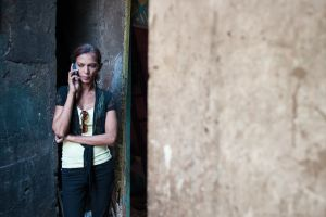 Urmi makes a call outside one of The Humsafar trust's community offices.  © Alison McCauley