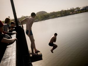 Young boys enjoy a warm day at the main park in Donetsk.