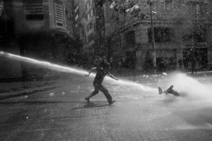 "The violent reaction by the police continued throughout the day. Quickly, the protester's numbers began to swell. In response, the police resorted to more tear gas, pepper spray, and firehoses. From the series ""Witnessing Gezi"" © Emin Ozmen"