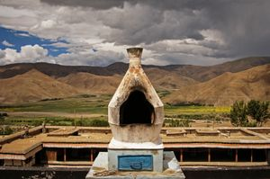 This large chorten or incense burner is on the roof of Mindroling Monastery near Dranang, Tibet. It was photographed on 1 July 2005. © Forest McMullin