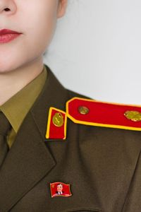 A North Korean lady in uniform with the obligatory pin of the Leader.