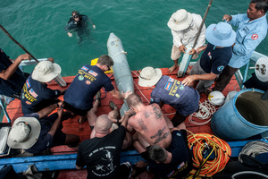 UXO salvage divers and members of the USA 7th Engineer Dive Detachment takes part in the training programme off the coast of Sihanoukville, Cambodia. In this exercise the team was learning how to recover large inert ordinance using airbags to raise the item from the sea bed.