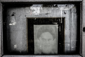 The picture of Imam Khomeini on the grave of an unknown martyr.