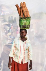 Ayaa Margaret: Sells Cassava, 3 for 1,000 shillings ($0.32).