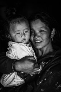 Dhan Maya Ghale hugging her child. A resident of Barpak where the epicenter of the 2015 earthquake was. She lost her daughters, a 6-year-old girl, and a 3-day-old infant.