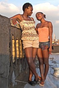 Dreams: Rosseline Fungisayi Chikowore and Tinoh Lindsay Chadza, reunited, on the rooftop in New Jersey, overlooking Midtown, Manhattan.