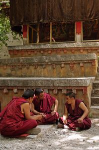 Sera Monastery is outside of Lhasa, Tibet. It is known for the dramatic debates held every day in a grove of trees.Some take a more contemplative approach, quietly and intimately discussing religious issues. Photographed on 29 June 2005© Forest McMullin