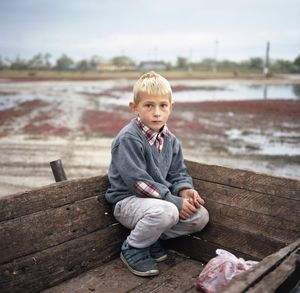 Vlăduț just went shopping with his parents in the village center of Letea, Danube Delta, Romania. © Ioana Cîrlig, winner in the Portrait category