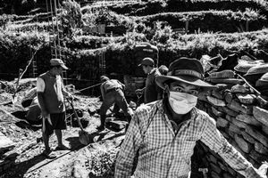 Men rebuilding houses destroyed by the earthquake of April 2015. Mandre, Gorkha District, near the epicenter