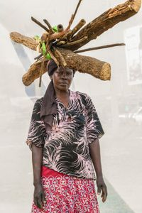 A. Christine; Sells firewood bundels for 5,000 shillings. Earns about 80,000 shillings per day.