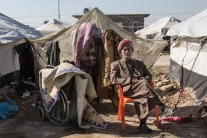 22/01/2015 -- Kirkuk, Iraq -- A portrait of Qasim Sleman 66 Y.O. in front of his tent in Laylan IDP camp, South of Kirkuk. Qasim is from Falujah.