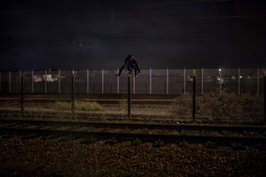 Migrant trying to cross the border of Frethun train station in the northern French city of Calais on November 7, 2015.