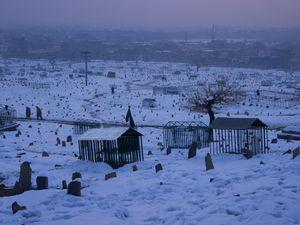 A Shia cemetery on the flanks of Kohe Asmai. © Simon Norfolk.