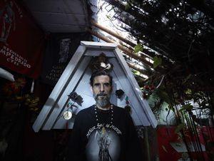 San la Muerte devotee who heals in the name of the popular saint in his  garden dedicated to San la Muerte in Buenos Aires suburbs of Vittoria