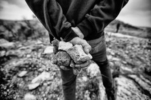 Rocks in the hands of a Palestinian demonstrator in Nabi Saleh. Dec. 7, 2013. West Bank, Palestine.