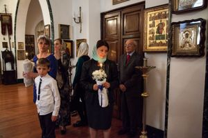Russian Orthodox member of the Church of San Nicola, in the neighborhood of Termini, get ready to celebrate the baptism of a little boy.