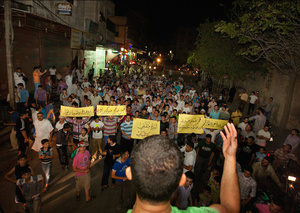 The youth of Al Bab, protesting nightly. A young man stands on a mini-bus leads the call and response sloganeering as they make their way through the streets.