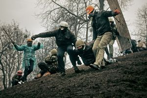 Protesters transporting wounded comrade (Ukraine, Kiev, February, 2014)