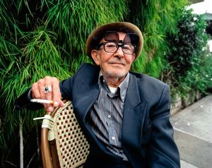 La Poubelle, established in 1969, has been serving French food in the same spot on Franklin Ave, Los Angeles for four decades. Locals regard it as a Hollywood landmark. On the sidewalk a man sits in a rattan bistro chair near the valet podium.