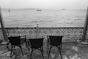 Wicker chairs on a veranda overlooking the Bosphorus.
