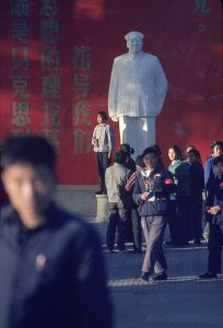 November 1966. Beihai Park. The young people pose for a photo with their Little Red Books in front of the statue of Mao Zedong. © Solange Brand