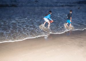 Children play on La Ropa beach. Zihuatanejo.