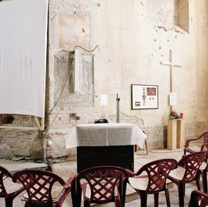 Make-shift altar and seating in the damaged Cathedral. Ethnic differences in the region follow religious lines with Catholic Croats and Orthadox Serbs. © Colin Dutton