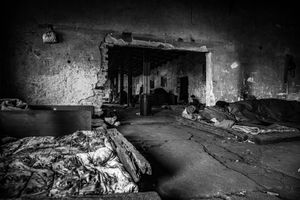 Inside a derelict warehouse, which is shelter for refugees. Belgrad, Sebia.