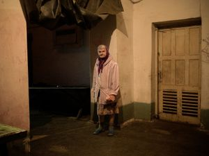 An inhabitant of a 1970s bomb shelter in Donetsk where she and her son have been living for three years.