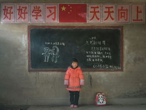 """""""Zhang Zhiyii, Gansu province. She wrote down: Dad lost money gambling, He also severely hit mother"""".  From the Series """"Left-behind Children"""""""